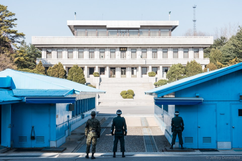 Looking north. Notice the North Korean guards are on the south side of the border (the whole are is a neutral zone, and guards from either side can roam free there), looking north. Their aim is to prevent people from traveling from the north to the south.
