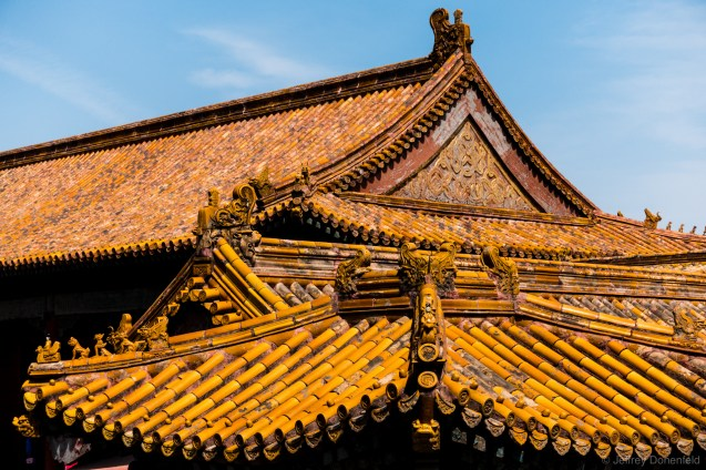 Orange tiles protecting the roofs of the Forbidden City fro m the afternoon sun.