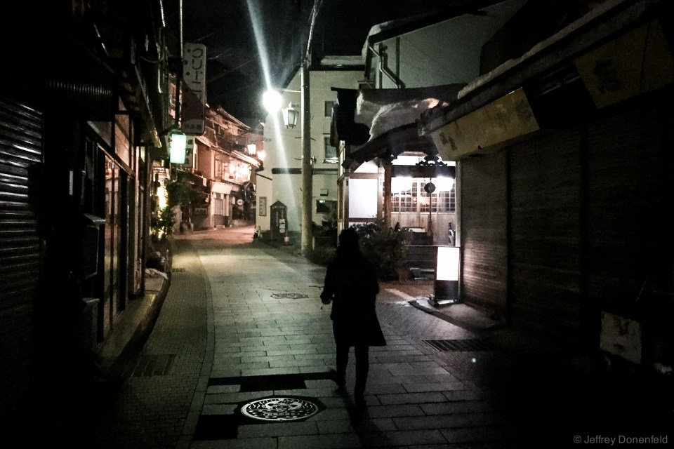 Walking through the streets of Shibu Onsen at night. The traditional town is beautifully old-worldly, with cobblestone streets and traditional houses. Also, streams of geothermally heated onsen water  bubble from pipes and vents everywhere.