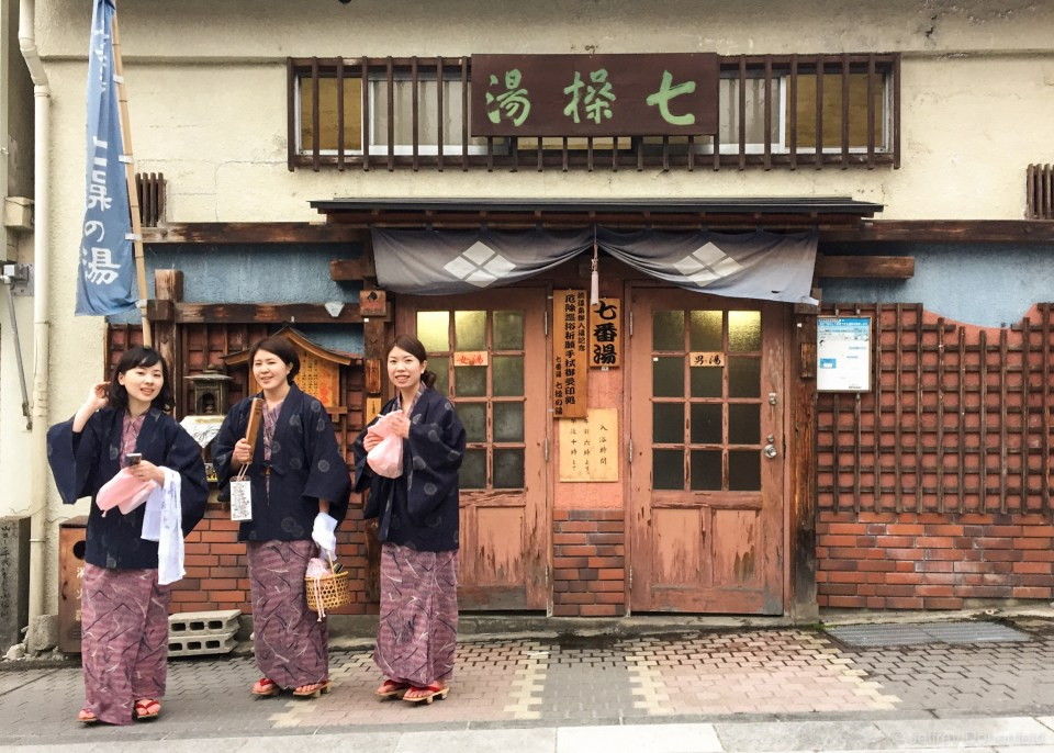 The onsen path is popular, and people show up in all sorts of nice robes. You can also see these women are wearing the traditional wodden onsen flip flops. They're not super comfortable, but it is possible to walk around town in them. The two wood bars on the bottom facilitate a rocking motion when walking.