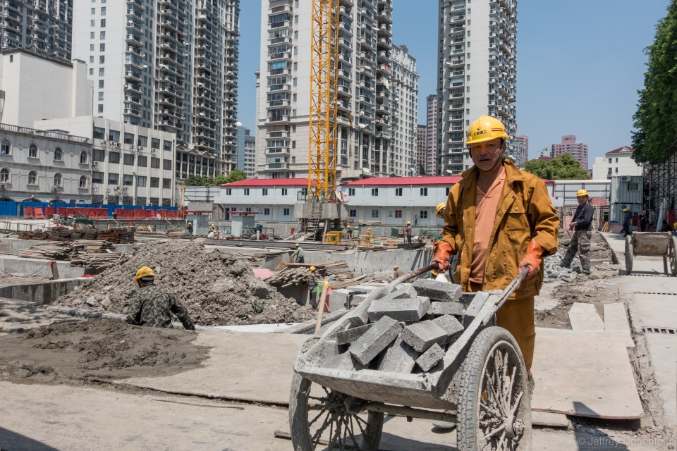 Walking down the street in Shanghai, this is a common scene - building going on everywhere. In order for buildings to be buit faster, they house workers directly on site, to cut out the commute, and maximize working hours.