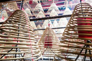 Exploring the legendary Man Mo Temple, with coils of incense burning everywhere.