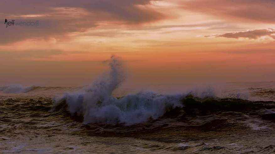 Waves breaking in Depoe Bay at Sunset photographed by Jeff Wendorff