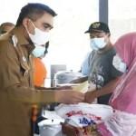 Wakil Bupati Karo Serahkan Bantuan Kebakaran di Desa Ujung Deleng