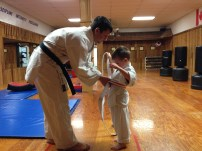 Receiving your orange stripe belt.