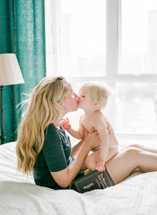 Mother and toddler kiss