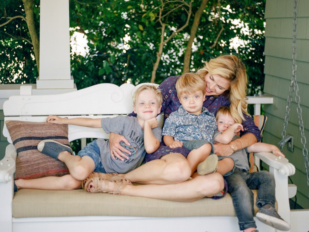 mom and kids on porch swing