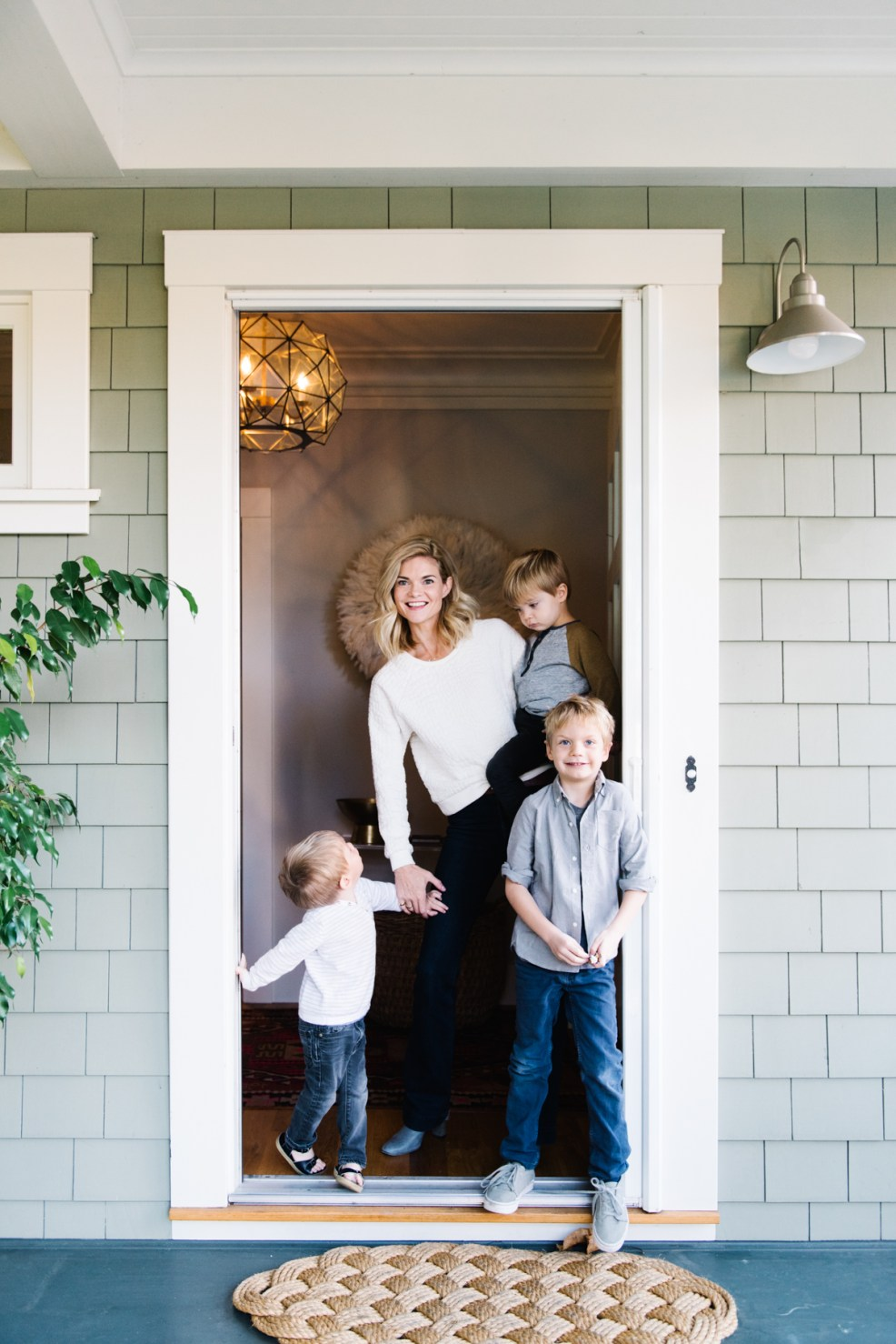 mom and boys in doorway