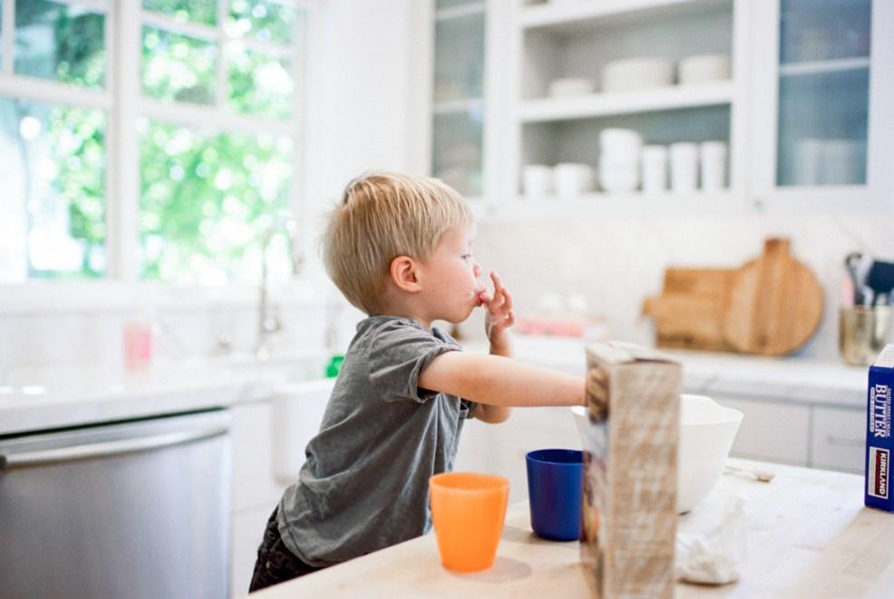 child licking his finger