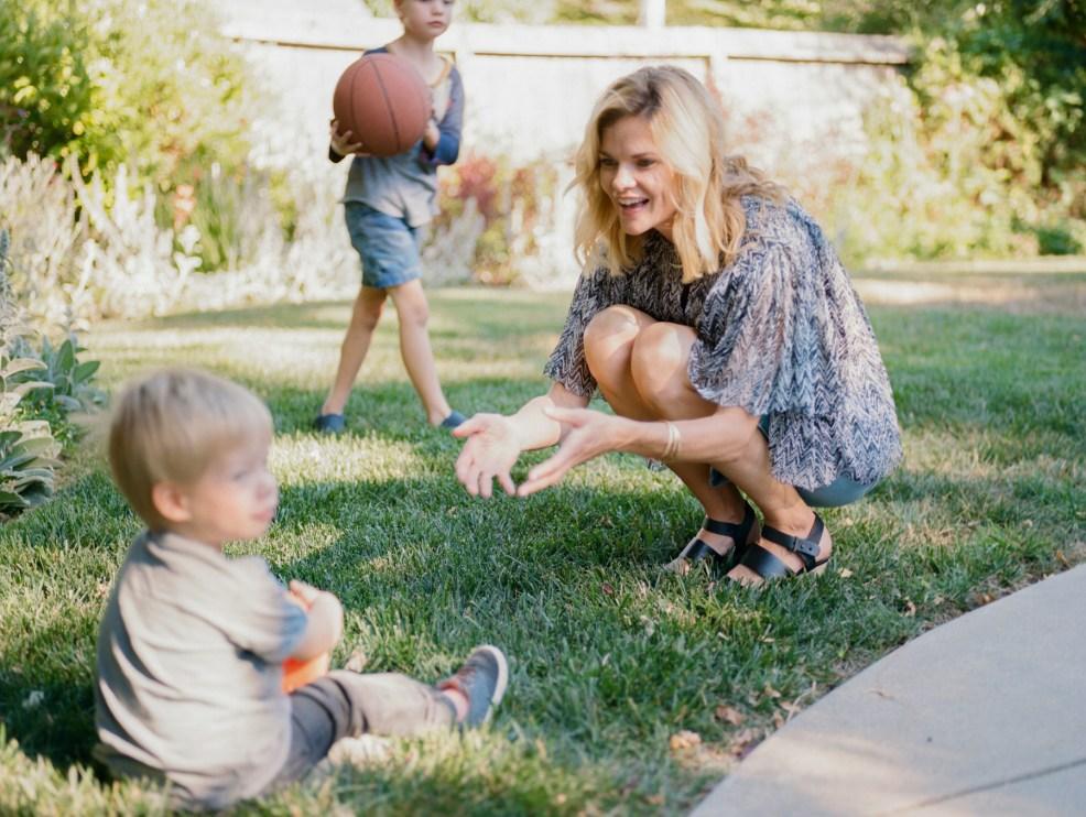 mom playing ball with kids