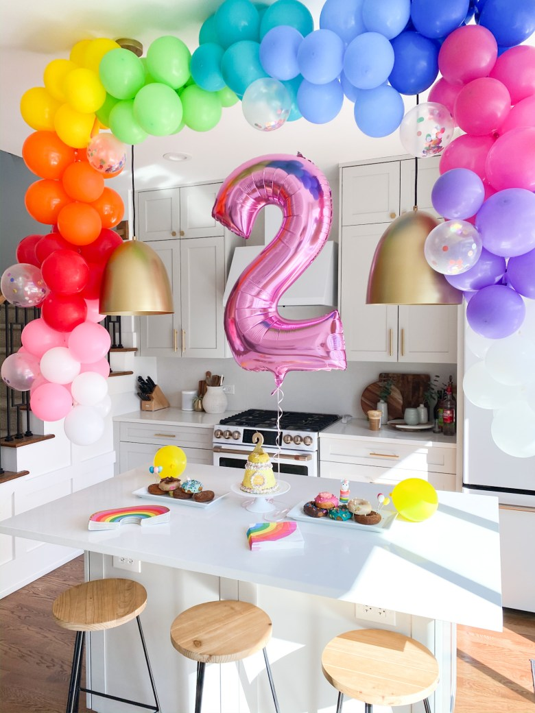 best toddler birthday party themes rainbow balloon arch
