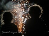 Photography of children silhouetted by fireworks