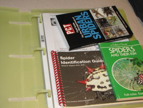 Unikeep binder open with papers and small books