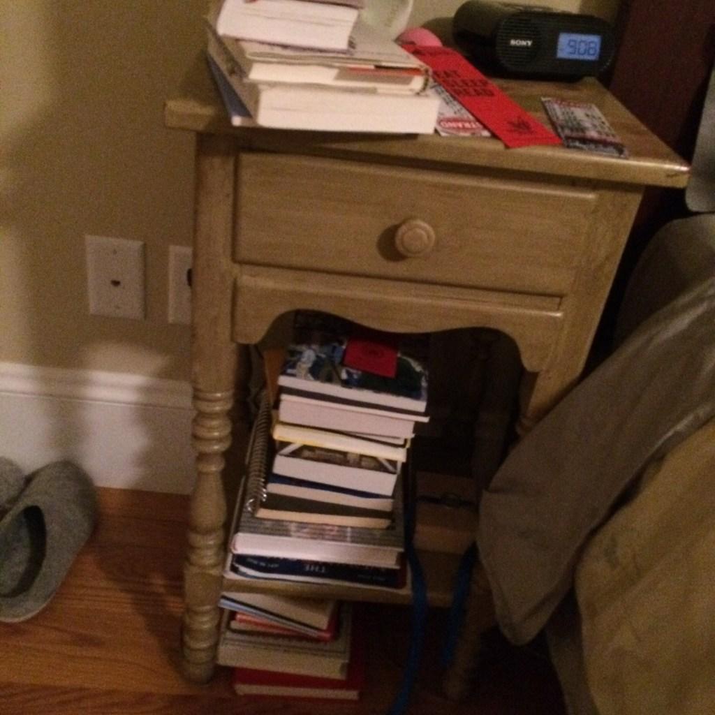 Bedside stack of books