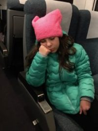 Sleepy girl on train