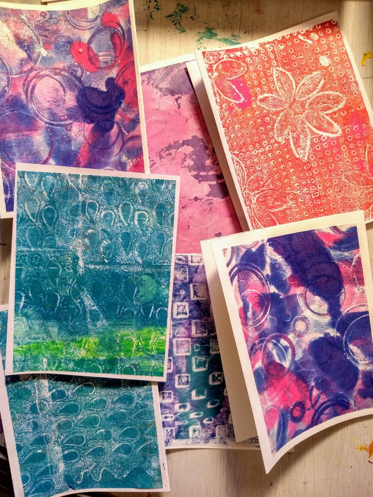 Pile of cards made with gel prints. (no images yet.)