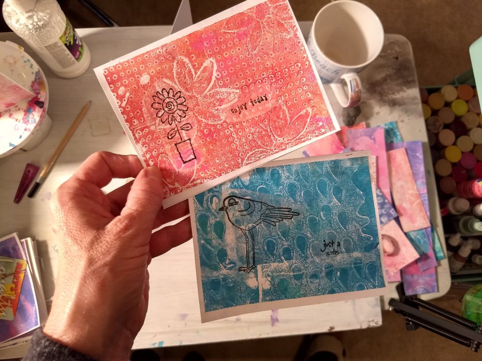 2 Cards made using gel prints and stamps on tracing paper.