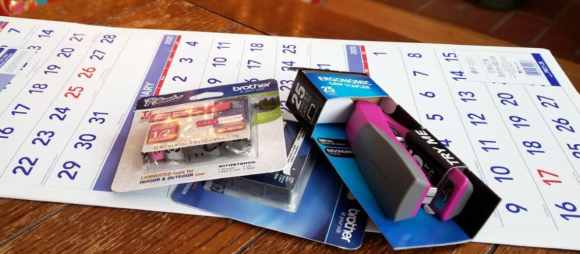 Office supplies including a calendar and stapler