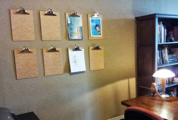 The clipboards will hold fan art, book covers, sketches, magazine clippings, photographs, etc.