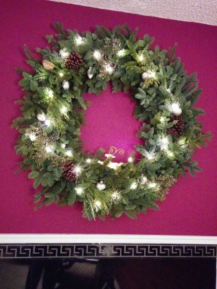 Our festive wreath, hung high enough that it's safe from the cats.
