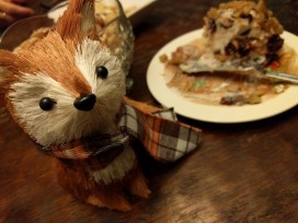 A holiday party at Kate's, complete with tiny fox and cheese ball.