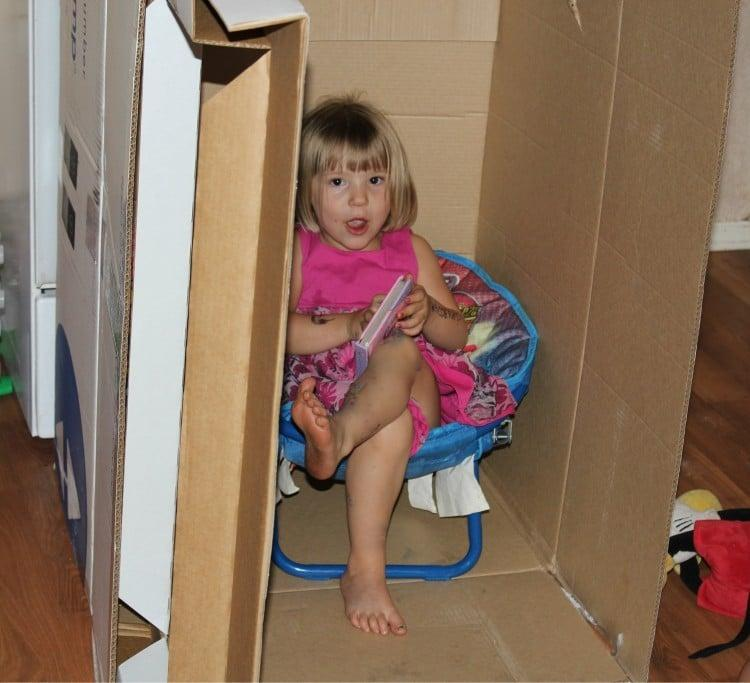 kids having fun with a box
