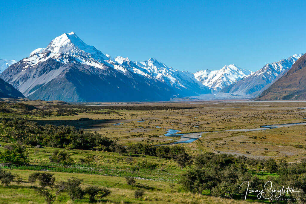 Aoraki and the Southern Alps rise behind a view of the wide Tasman River Valley.