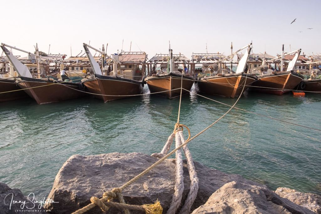 A row of dhows tied up in the harbour on Masirah Island