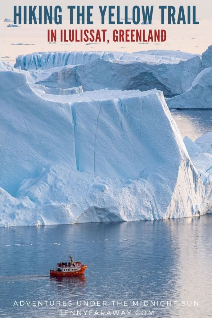 A boat sails near the enormous icebergs of the Ilulissat Icefjord, Greenland.