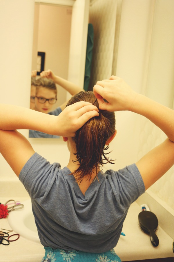 daughter using Goody hair ties via @jennyonthespot