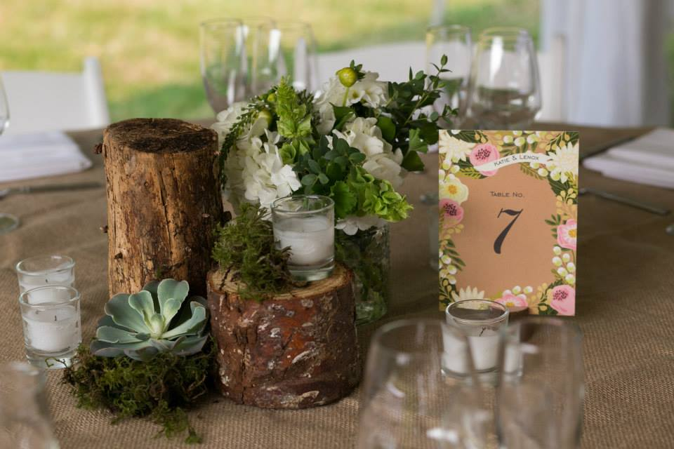 Centerpiece with wood rounds, succulents, and flowers