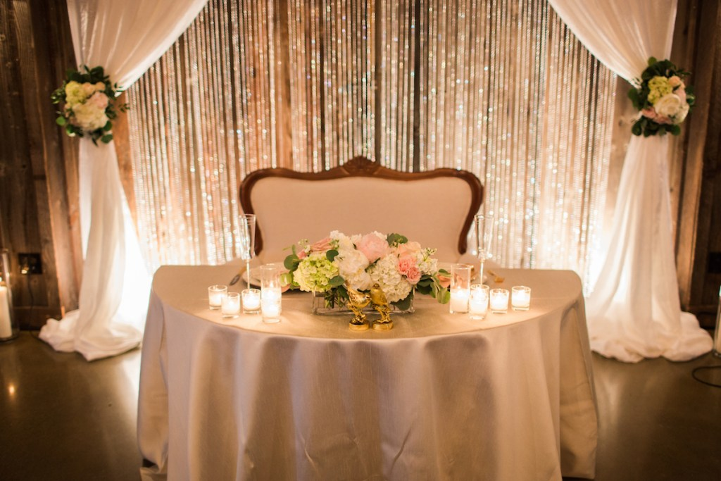 Sweetheart table with vintage settee at Kelley Farm. Planning & Flowers by Jen's Blossoms