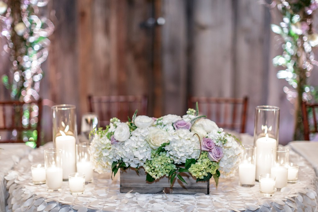 Head Table Centerpiece: long wood box of hydrangea and roses accented with candles