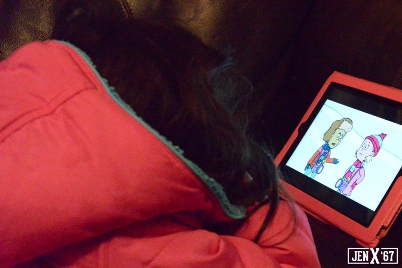 Little Girl plays on iPad while she waits for it to snow.