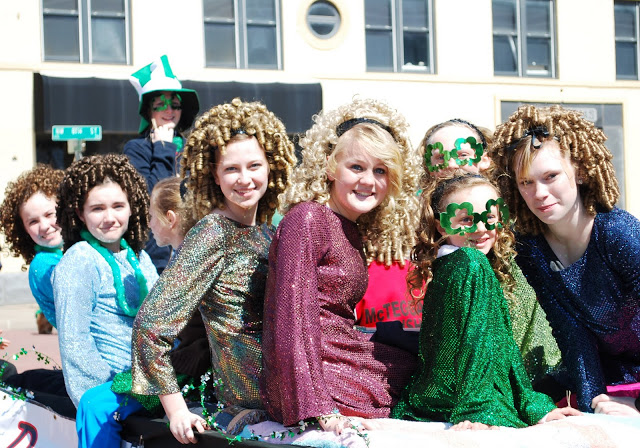 Irish Dancers wearing those curly wigs