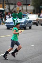 Kid chasing Candy at parade