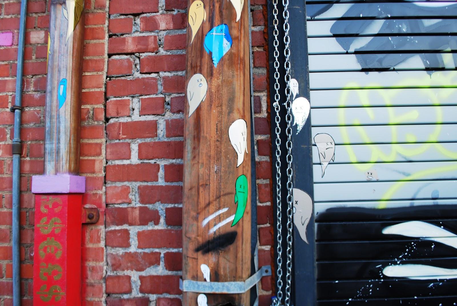 Graffiti Stickers on a light pole