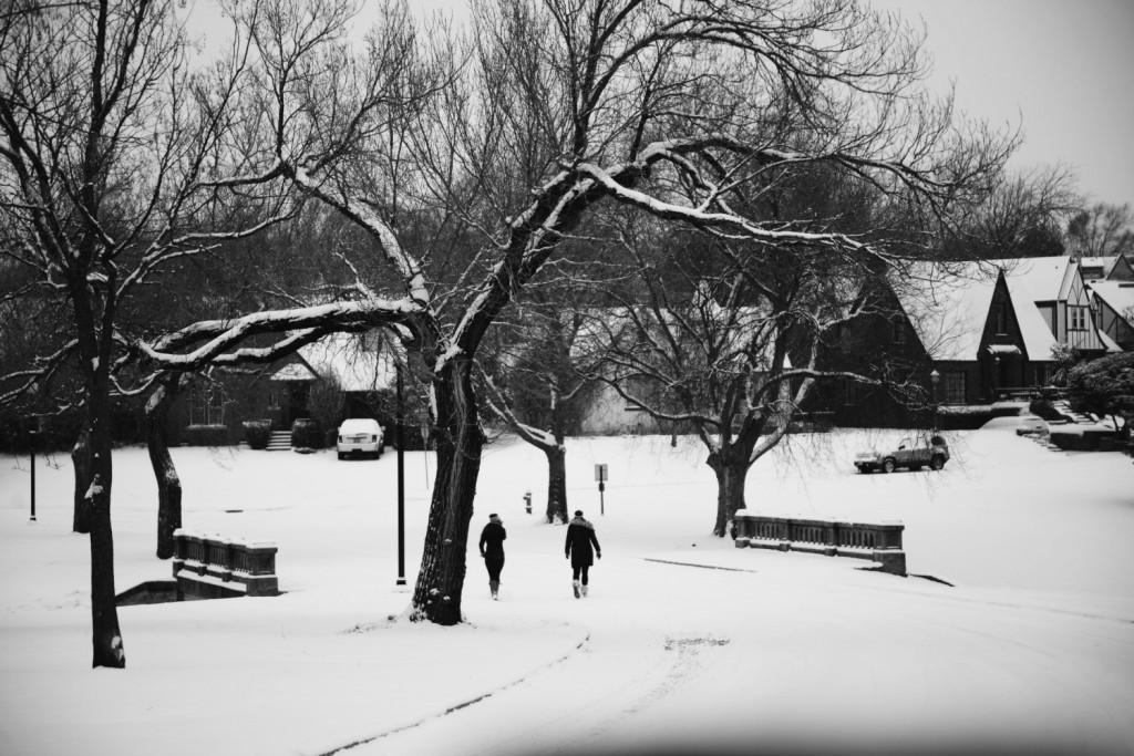 People Walking in the snow across bridge