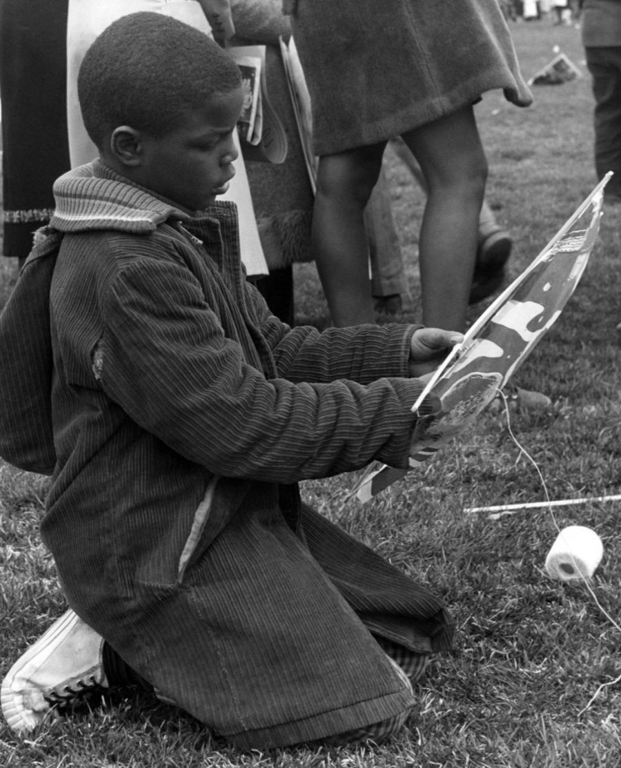 African American Boy Prepares a poster for a march in D.C.