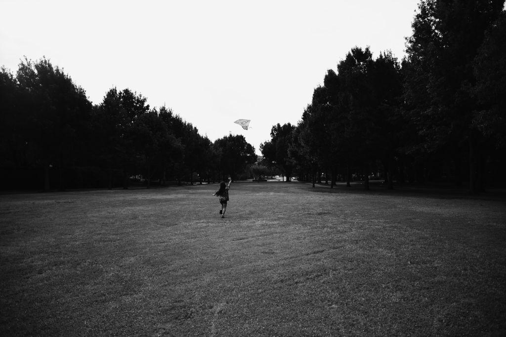 Running through field with kite