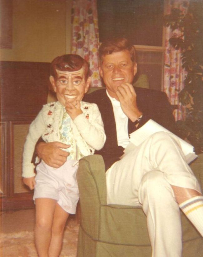 Caroline Kennedy dons a JFK mask as she strikes a Halloween pose with her father, the late President John F. Kennedy.