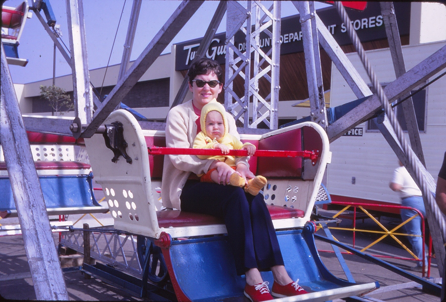1971: A mother rides a Ferris wheel her infant son.