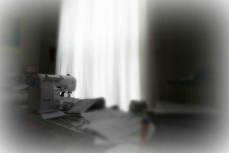 Moms Sewing Machine and White Curtains After She died