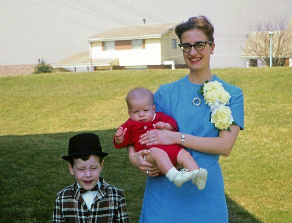 Mom with a giant corsage and rad 1960s cat eye glasses. I also love her circle rhinestone brooch.