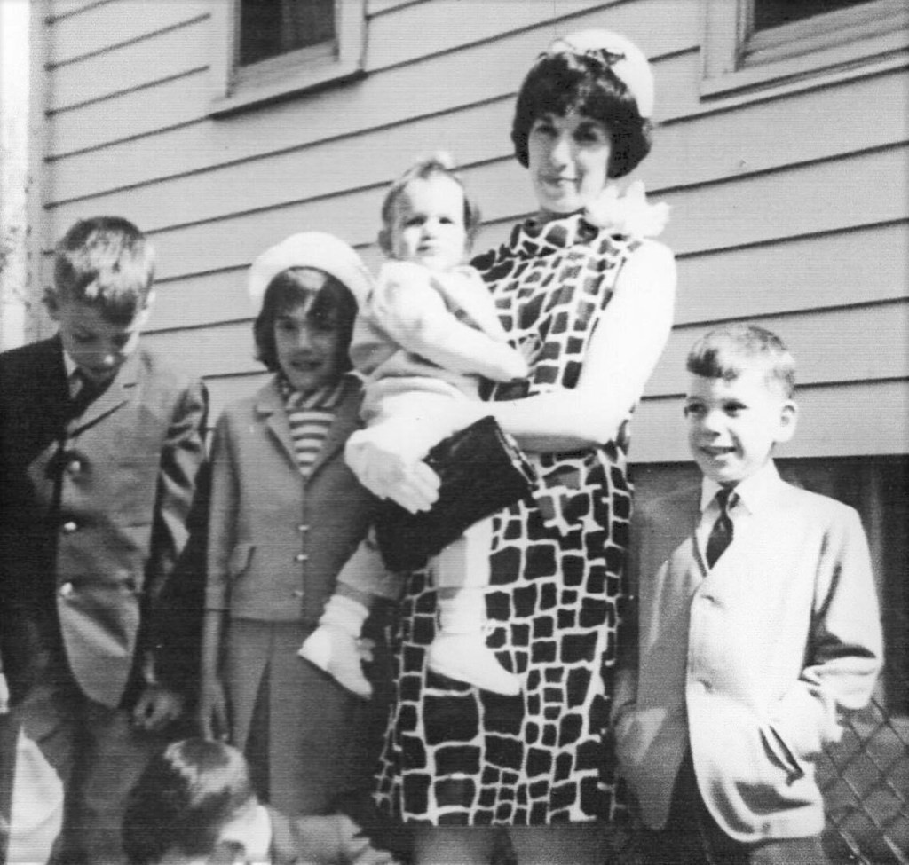 This mom had the privilege of raising at least two Boomers and three Gen-Xers. Note the boy's head in the bottom edge of the frame. Poor, Mom living with all that generational madness. But, hey she's rocking a great giraffe print and corsage. Mother's Day corsages are so rare these days. My dad always bought my mom one.