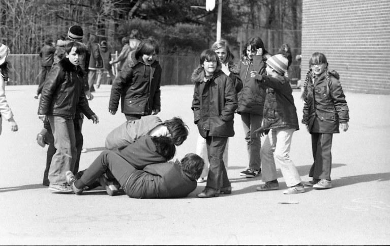 Boys wrestling on a school playground Generation X 1974