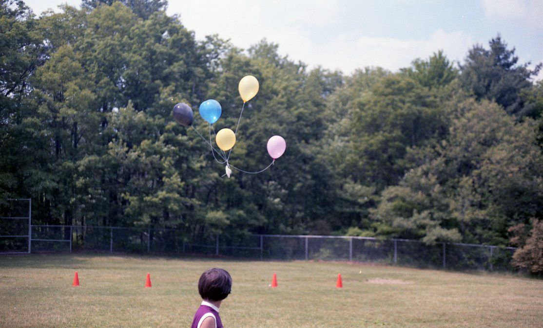 Girl Releases Balloons