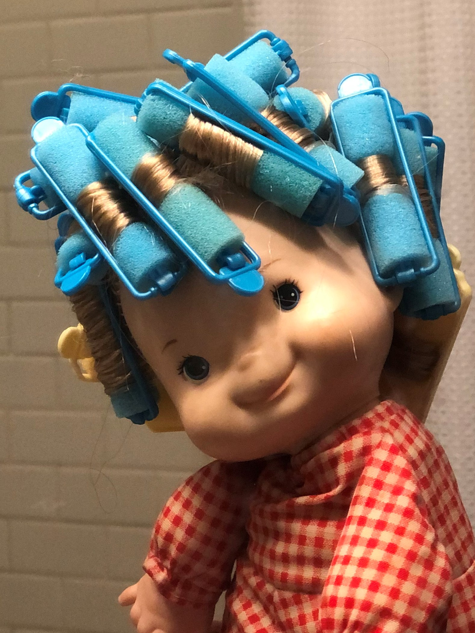 a doll with rollers in her hair