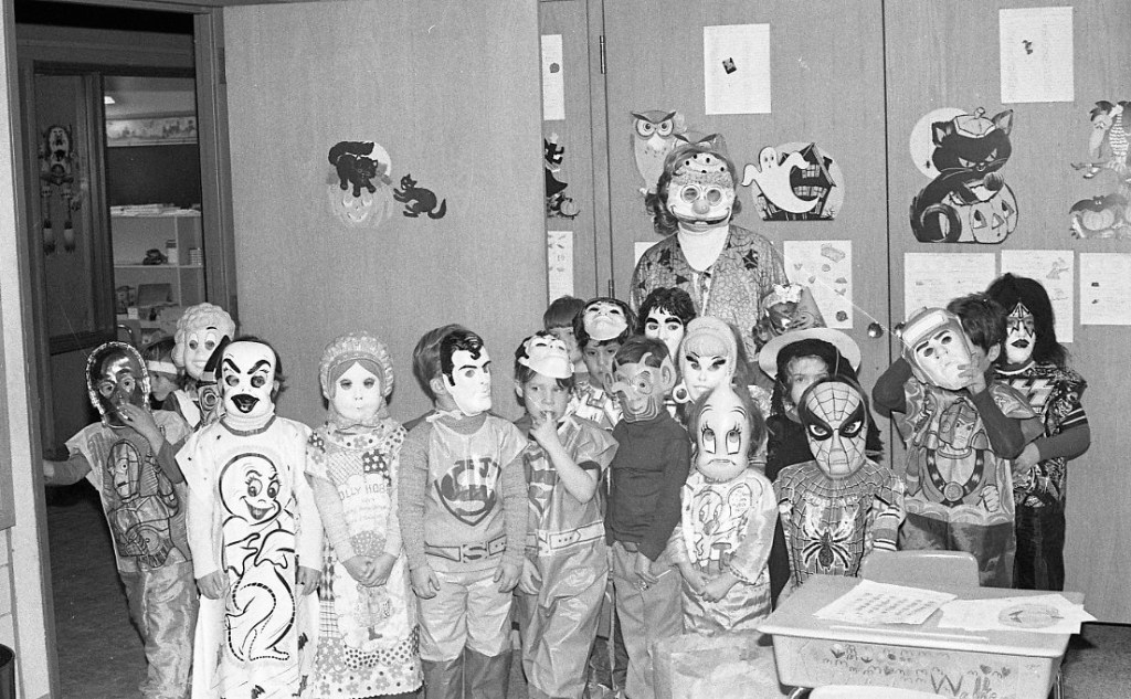 Kids in 1979 dress up in a variety of Ben Cooper and Collegeville costumes including Star Wars C-P30; evil Casper the Friendly Ghost; Holly Hobbie, Superman; Daffy Duck; Kiss and Cinderella.