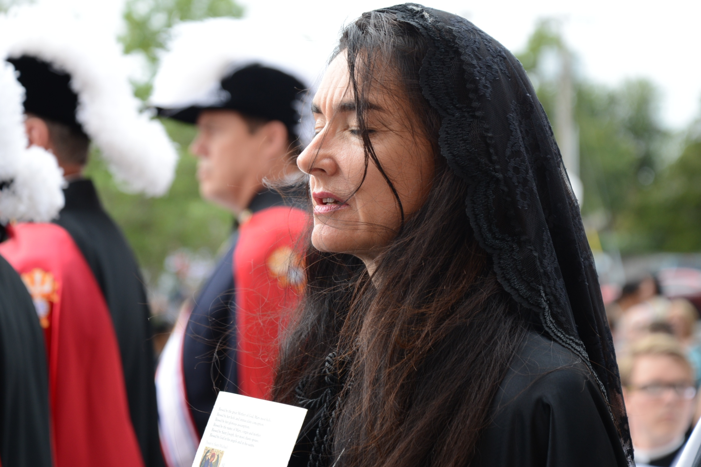 Woman in black prayer veil
